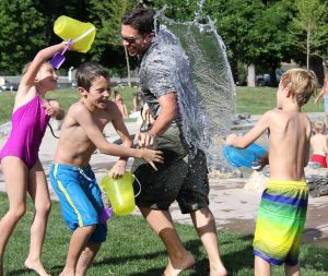 9 Fun Ideas for Water Activities to do with your Children in the Back Garden - bucket play.