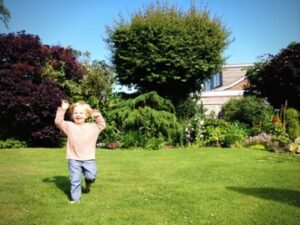 kid playing in garden